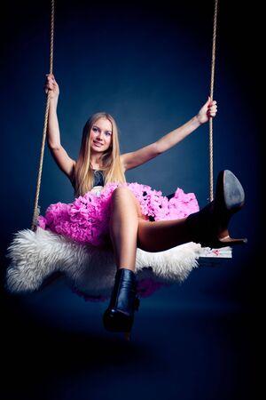 beautiful long haired woman on swing Stock Photo