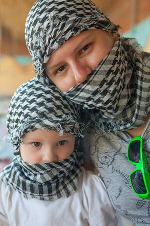 kerchief: pretty little girl with mother in bedouin kerchief