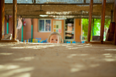 seek: Beautiful girl playing hide and seek