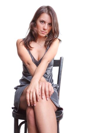 Beautiful woman in gray dress sit on chair