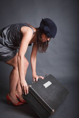 Beautiful woman in black hat with suitcase Stock Photo