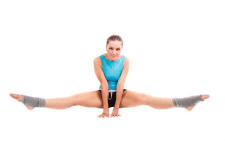 Young sports woman sits on the splits Stock Photo