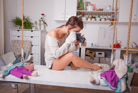 Funny sexy woman photographed in the white kitchen