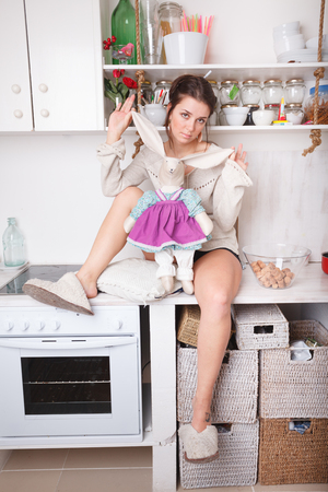 Funny sexy woman in the white kitchen
