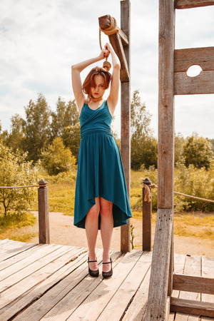 Young beautiful woman posing on gallows