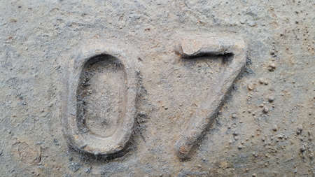 Metal number 7. Texture of rusty metal in the form of figures 7 Stockfoto