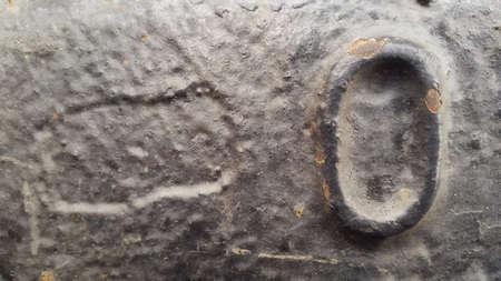 Metal number 0. Texture of rusty metal in the form of figures 0. Stockfoto