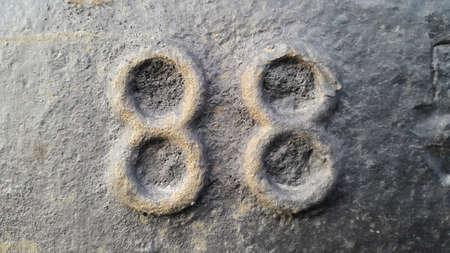Metal number 88. Texture of rusty metal in the form of figures 88. Stockfoto
