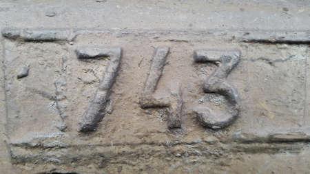 Metal number 743. Texture of rusty metal in the form of figures 743.