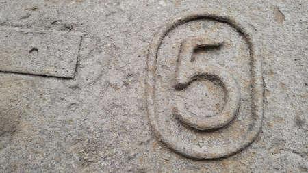 Metal number 5. Texture of rusty metal in the form of figures 5