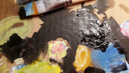 oil paints and paint brushes on a palette.
