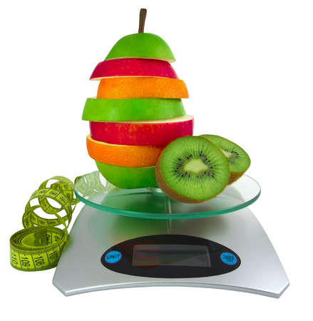 The mixed fruit on scales and a measurement tape photo