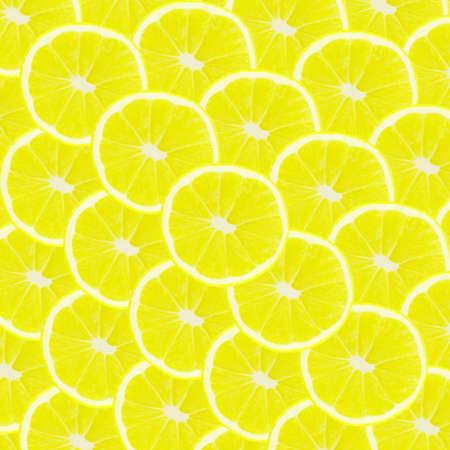 Yellow background with citrus fruit of lemon slices 版權商用圖片