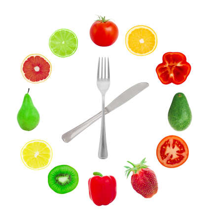 Hours from fruit on a white background photo