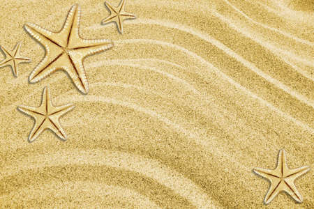 Background from sand with starfishes Stock Photo