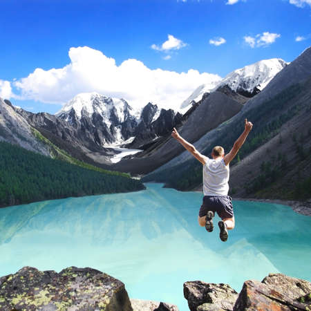 Mountain landscape with the lake and the jumping man