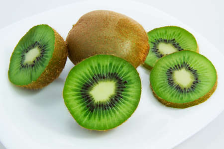 reasonable: Reasonable kiwis on a plate
