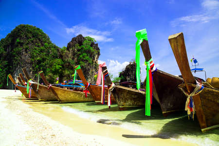 Long tail boat on beautiful tropical beach, Krabi, Thailand - Holiday vacation concept background photo