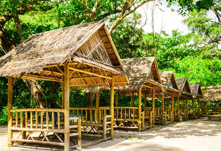 Small huts for a dinner in the jungle photo