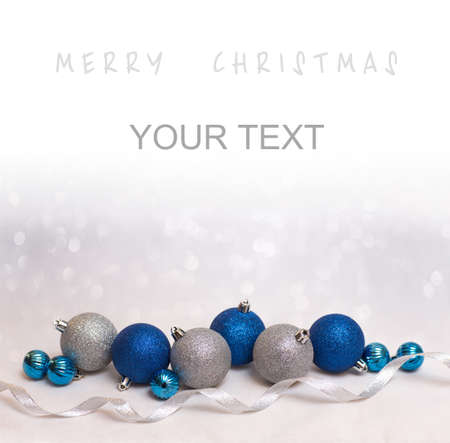 bokeh background: Beautiful Christmas background with blue and white christmas balls for xmas design with space for text Stock Photo