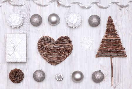 Christmas (New Year) decoration background: tree, balls, heart, gift on wooden desk 版權商用圖片