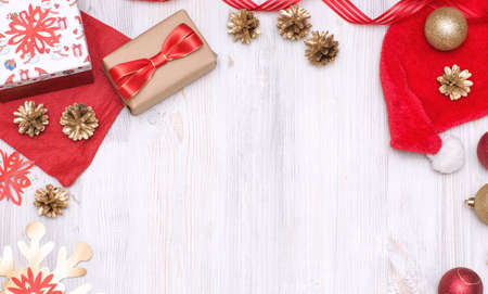 Merry Christmas and Happy New Year golden and red decorations on a white background. Top view with copy space