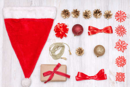 Merry Christmas and Happy New Year golden and red decorations on a wooden background. Top view