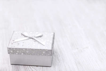 Christmas white gift box on wooden board