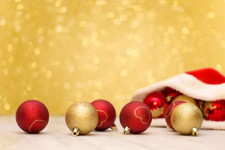 Christmas background. Santa Claus hat and red  and gold balls 版權商用圖片