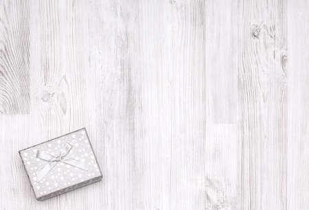 Christmas white gift box on wooden board. Top view 版權商用圖片
