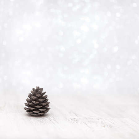 Christmas decoration on white background with pine cone, soft focus