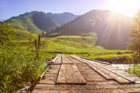 sunrise mountain: Sunrise mountain landscape with wooden bridge Stock Photo