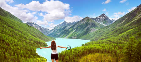 Freedom concept. Beauty girl in mountains on background view Kucherla lake on Altay
