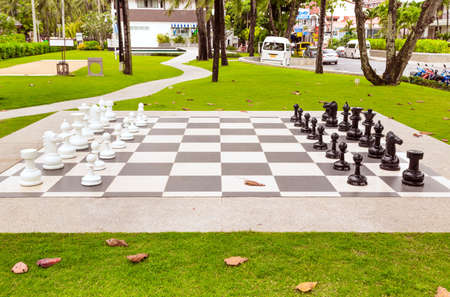 Big chess on green lawn in sunny day, Thailand, Phuket