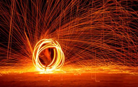 Fire Show at night on Phi-Phi island Holiday travelers. Thailand 版權商用圖片