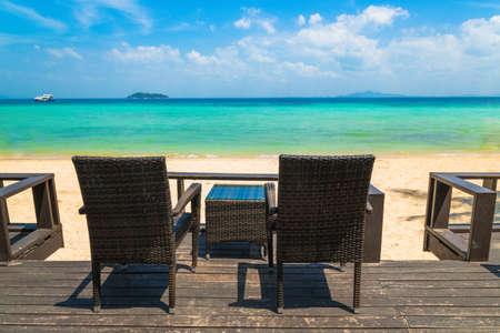 Beach chairs on the white sand beach at summer terrace restaurant - Phi-Phi island, Krabi Province, Thailand