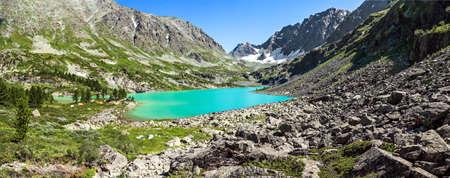 Mountain landscape, beautiful turquoise lake and mountain range, large panorama, Altai, Russia.