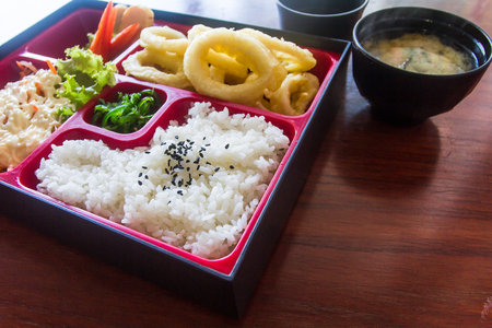 Bento set on the table in selective focus. Japanese food style.