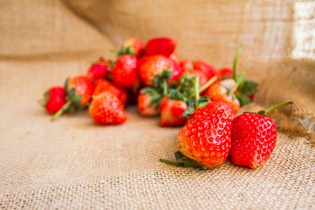Portrait of Strawberrys refreshing to put on sackcloth background.
