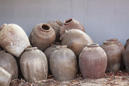 Several old jars are placed on the ground had been used in the fermentation of food. Reklamní fotografie