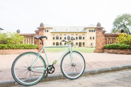 Bicycle and antique buildings which is the background. Stock Photo