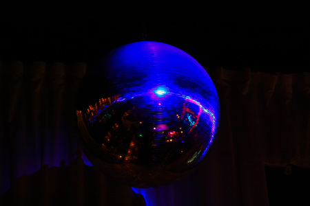 In the pub spinning mirror balls. Reflect the light touch