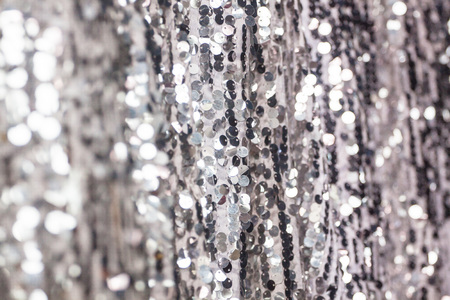 Silver sequin embroidery fabric is used to decorate the place of work is driving, which is used as a background.