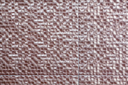 Copper tiles used as wall decoration of the premises which is used as a background.