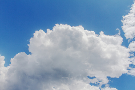Blue sky and clouds of white is used as the background.