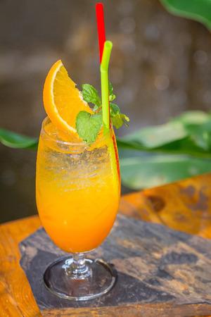 Orange juice and soda, considered them ready to serve. Zdjęcie Seryjne