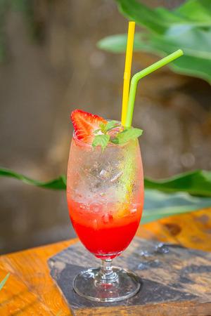 Strawberry juice and soda, considered them ready to serve. Zdjęcie Seryjne