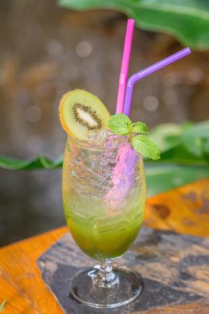 Kiwi juice mix soda set on the table ready to serve. Zdjęcie Seryjne