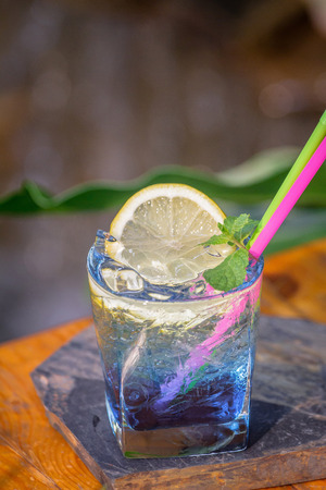 Blue Hawaii mix soda in short glass set on the table ready to serve. Zdjęcie Seryjne
