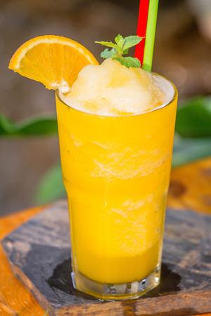 Orange juice Frappe set on the table ready to serve. Zdjęcie Seryjne